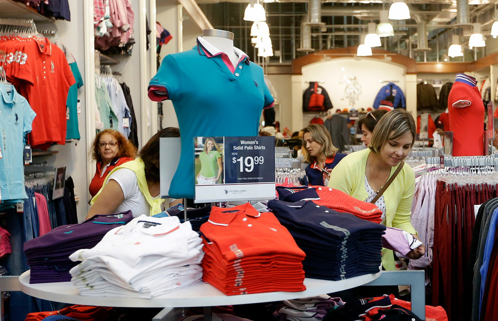 . Vanusa Fonseca, right, of Brazil, shops at a U.S. Polo Assn store on Black Friday, Nov. 25, 2016, in Miami. Stores opened their doors Friday for what is still one of the busiest days of the year, even as the start of the holiday season edges ever earlier. (AP Photo/Alan Diaz)