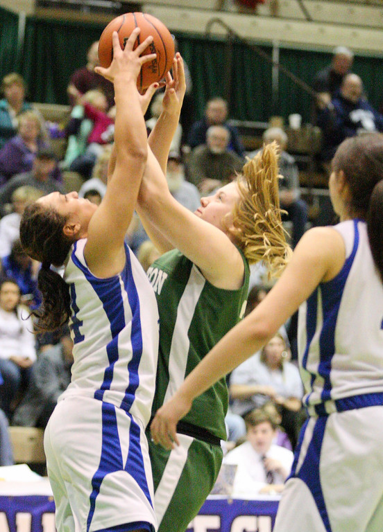 . Hamilton\'s Olivia Dow (24) and Ft Edwards  Alexis Thomas (24) tie up for the rebound in the second half of the NYSPHSAA Class D semifinal in Troy on Saturday, March 15, 2014.JOHN HAEGER-ONEIDA DAILY DISPATCH @ONEIDAPHOTO ON TWITTER