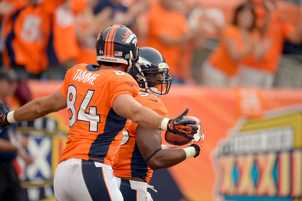 . Denver Broncos linebacker Steven Johnson (53) is congratulated by Denver Broncos tight end Jacob Tamme (84) after blocking a punt and returning it for a touchdown against the Philadelphia Eagles  September 29, 2013 at Sports Authority Field at Mile High in Denver. (Photo by John Leyba/The Denver Post)