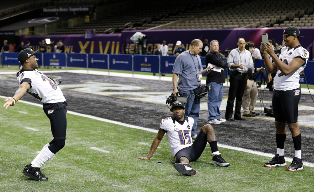 Description of . Baltimore Ravens cornerback Corey Graham (24) has some fun with LaQuan Williams (15) and Josh Bynes during media day for the NFL Super Bowl XLVII football game Tuesday, Jan. 29, 2013, in New Orleans. (AP Photo/Pat Semansky)