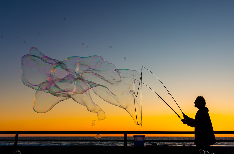 This guy shows up in Pacific Beach regularly, who creates a giant bubbles, just for fun and to entertain the kids and adults who were walking by.