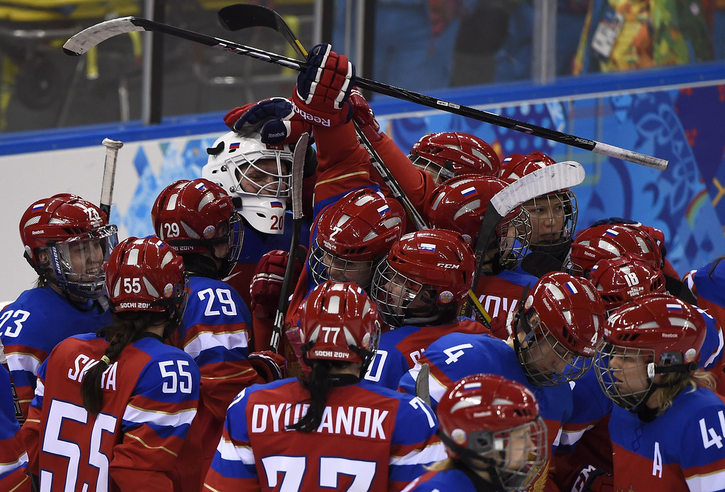 . Russia\'s players celebrate with teammate goalkeeper Yulia Leskina (C) their victory after a Women\'s Ice Hockey Group B match between Russia and Germany at the Shayba Arena during the Sochi Winter Olympics on February 9, 2014.     JONATHAN NACKSTRAND/AFP/Getty Images