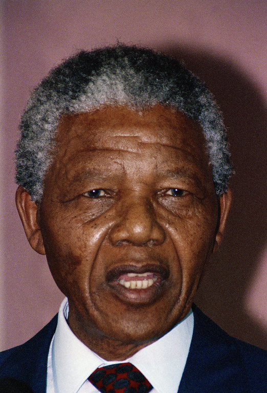 . Nelson Mandela speaks with reporters during a news conference at the World Trade Center in New York  Friday, June 22, 1990, before his appearance at the United Nations. (AP Photo/Peter Morgan)