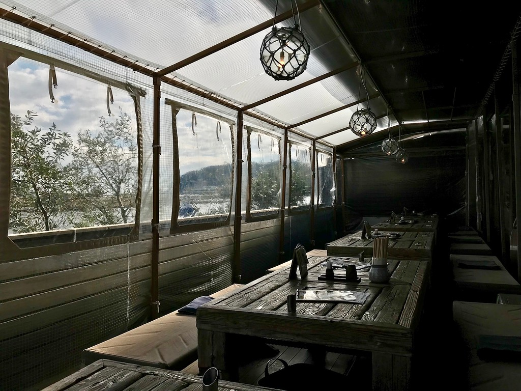 Covered terrace seating at Koya.