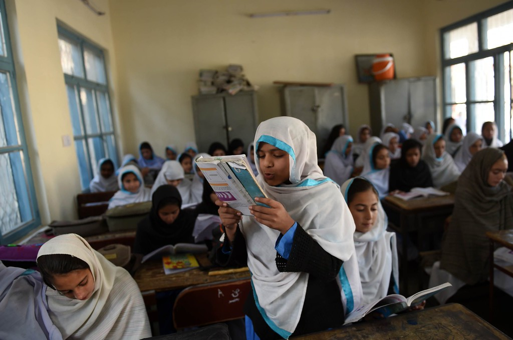 . A Pakistani schoolgirl wrireads from a book during class after offering prayers for Nobel Peace Prize laureate Malala Yousafzai during a school assembly in Mingora in the Swat valley on December 10, 2014. Schoolgirl activist Malala Yousafzai\'s courageous fightback from being shot by the Taliban has transformed her into a symbol for human rights and a campaigner in global demand.  AFP PHOTO / A MAJEEDA Majeed/AFP/Getty Images