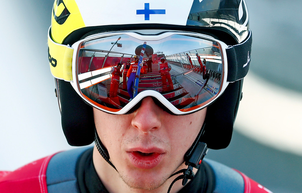 . Fellow jumpers are reflected in the goggles of Ilkka Herola, of Finland, during training for the men\'s nordic combined competition at the 2018 Winter Olympics in Pyeongchang, South Korea, Tuesday, Feb. 13, 2018. (AP Photo/Matthias Schrader)