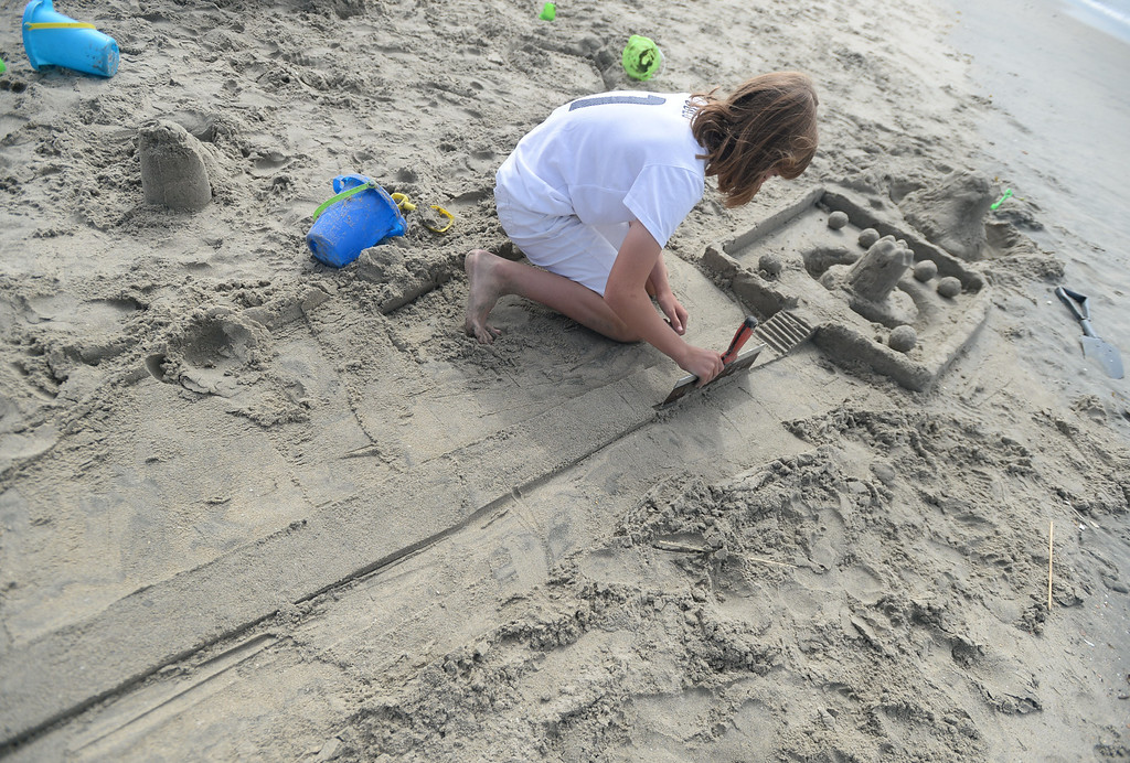 . Children had a chance to hone their sand castle building skills in a sand castle camp Monday at Granada Beach in Belmont Shore. Nicole Gates, 12, of Long Beach works on a long roadway leading to her castle. 20130805 Photo by Steve McCrank / Staff Photographer