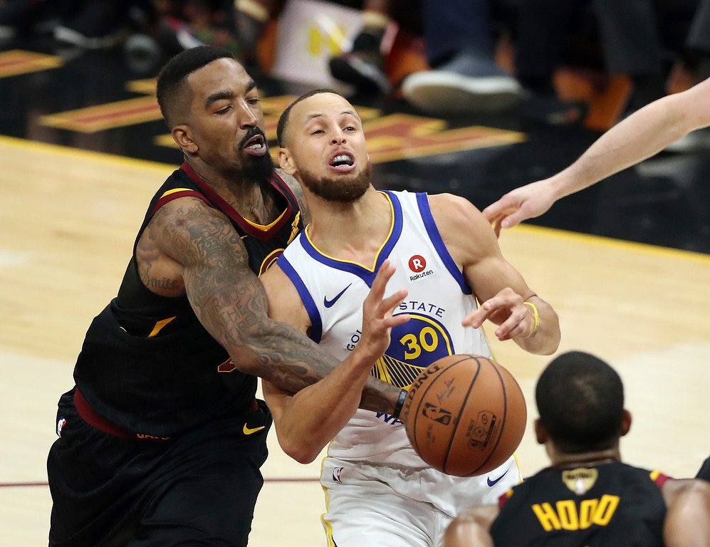 . Cleveland Cavaliers guard JR Smith, left, defends Golden State Warriors\' Stephen Curry during the second half of Game 3 of basketball\'s NBA Finals, Wednesday, June 6, 2018, in Cleveland. The Warriors defeated the Cavaliers 110-102 to take a 3-0 lead in the series. (AP Photo/Carlos Osorio)
