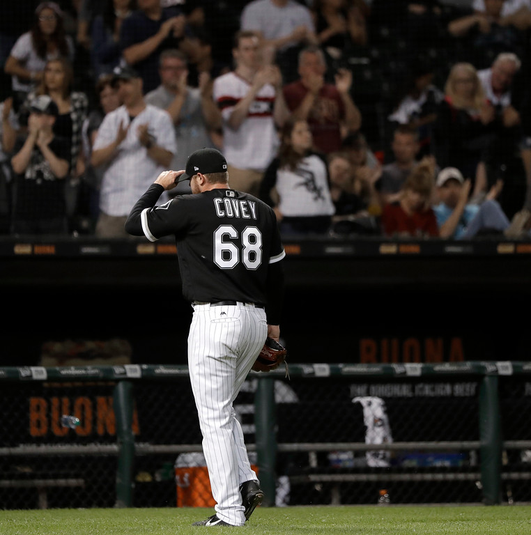 . Chicago White Sox starting pitcher Dylan Covey tips his cap to the fans as he is pulled in the eighth inning of the team\'s baseball game against the Cleveland Indians on Wednesday, June 13, 2018, in Chicago. (AP Photo/Charles Rex Arbogast)
