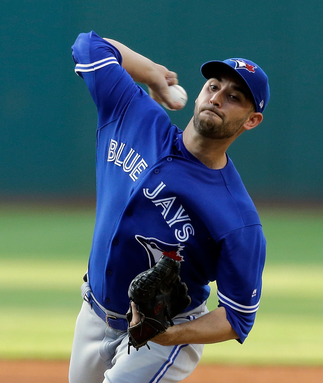 . Toronto Blue Jays starting pitcher Marco Estrada delivers in the first inning of a baseball game against the Cleveland Indians, Friday, July 21, 2017, in Cleveland. (AP Photo/Tony Dejak)