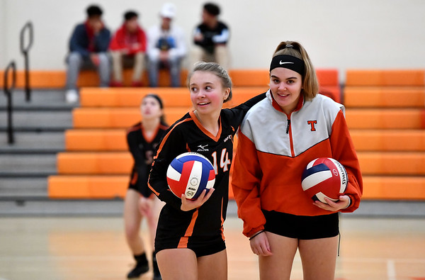 10/18/2019 Mike Orazzi | StaffTerryville's Bella Bergeron (14) and Taylor Barnett (15) during Friday night's girls volleyball match with Goodwin Tech in Terryville.