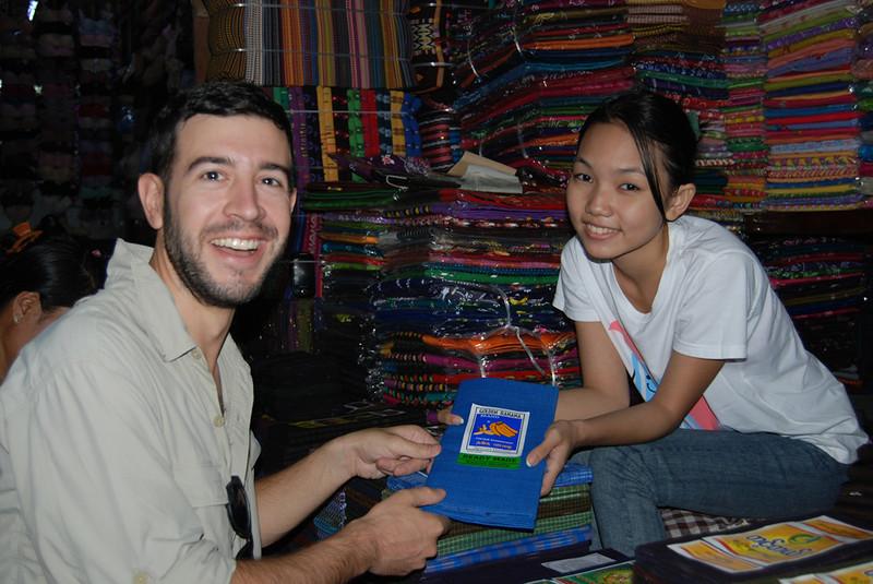 buying a lungyi in Myanmar.jpg