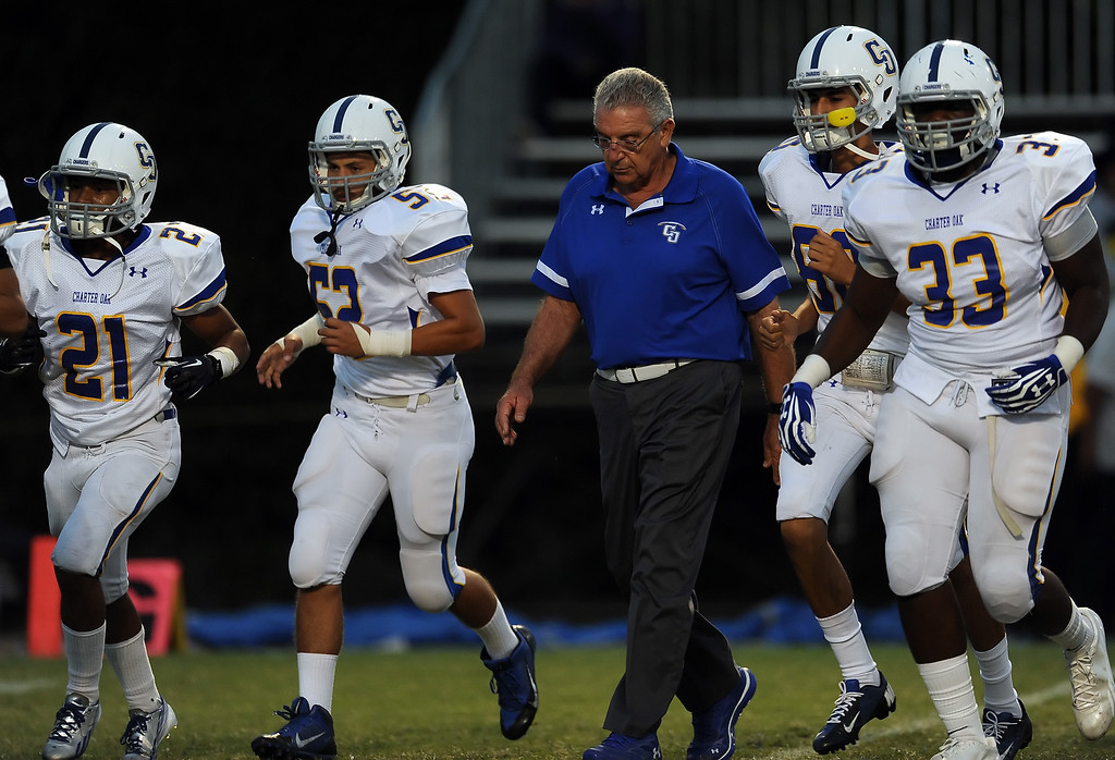 . Charter Oak head coach Lou Farrar walks off the field during a prep football game against Bishop Amat at Bishop Amat High School in La Puente, Calif. on Friday, Sept. 20, 2013.    (Photo by Keith Birmingham/Pasadena Star-News)