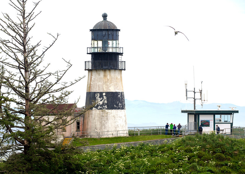 Adjacent the gun turret is the Cape Disappointment Light.
