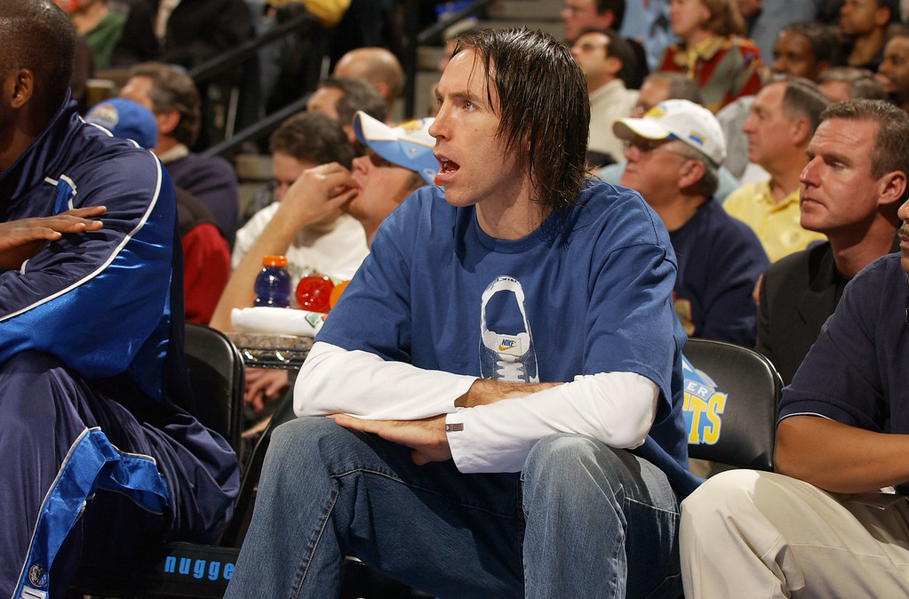 . Dallas Mavericks starting point guard Steve Nash takes a seat on the bench during the second half of the Mavericks\' 91-88 victory over the Denver Nuggets in Denver on Friday, Jan. 16, 2004. Nash injured his hip during the first quarter. (AP Photo/David Zalubowski)