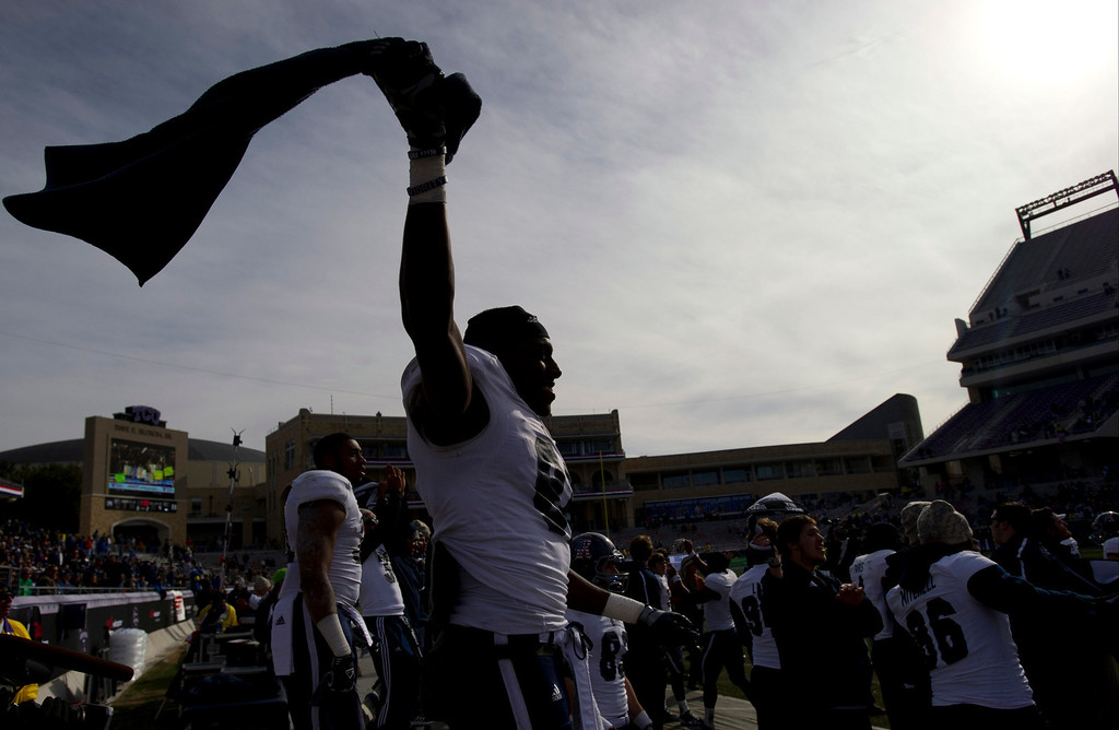 . Donte Moore #81 of the Rice Owls celebrates after defeating the Air Force Falcons on December 29, 2012 during the Bell Helicopter Armed Forces Bowl at Amon G. Carter Stadium in Fort Worth, Texas.  (Photo by Cooper Neill/Getty Images)