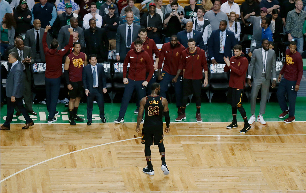 . Teammates applaud Cleveland Cavaliers forward LeBron James during the second half in Game 7 of the NBA basketball Eastern Conference finals against the Boston Celtics, Sunday, May 27, 2018, in Boston. (AP Photo/Charles Krupa)