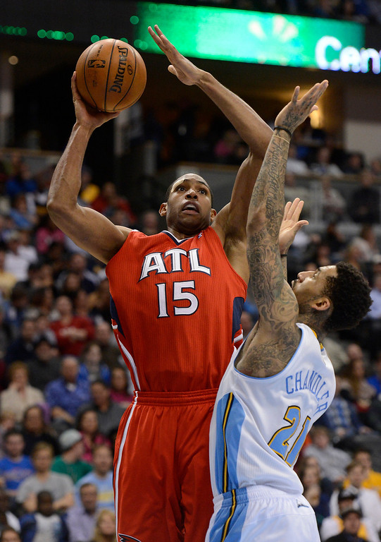 . Al Horford (15) of the Atlanta Hawks takes a shot over Wilson Chandler (21) of the Denver Nuggets during the fourth quarter March 4,  2013 at Pepsi Center. The Denver Nuggets defeated the Atlanta Hawks, 104-88. (Photo By John Leyba/The Denver Post)