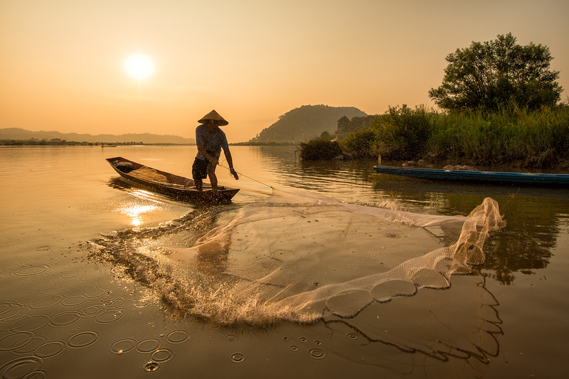 Fisherman and His Net, Sunrise along the Mekong River, Thailand