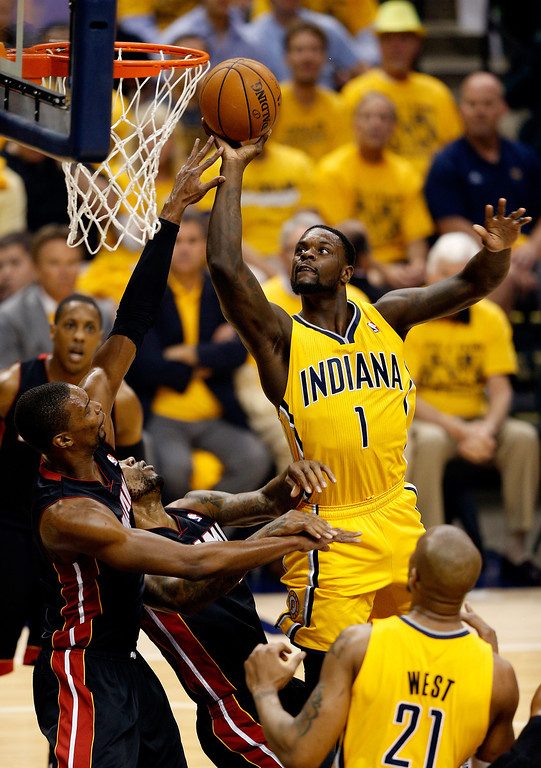 . INDIANAPOLIS, IN - MAY 20: Lance Stephenson #1 of the Indiana Pacers goes to the basket as Chris Bosh #1 of the Miami Heat defends during Game Two of the Eastern Conference Finals of the 2014 NBA Playoffs at at Bankers Life Fieldhouse on May 20, 2014 in Indianapolis, Indiana.   (Photo by Joe Robbins/Getty Images)