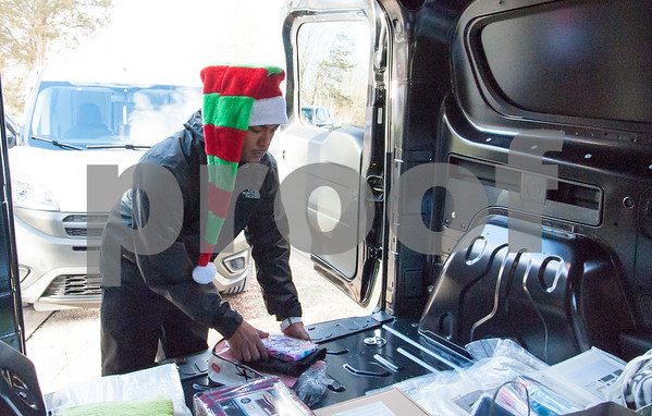 12/20/17 Wesley Bunnell | Staff Papas Dodge delivered donations to the Prudence Crandall Center on Wednesday afternoon as part of its fill the van drive held over the last several weeks. Household items were collected at the dealership such as bedding, clothes, small appliances and other household necessities clients of the center who are victims of domestic violence. Detail Department Supervisor Eugenio Rosario.
