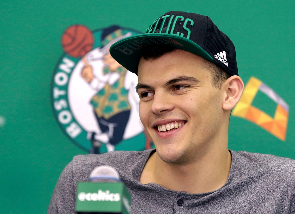 . Ante Zizic, of Croatia, a Boston Celtics basketball draft pick for 2016, smiles during an news conference Friday, June 24, 2016, in Waltham, Mass. (AP Photo/Elise Amendola)