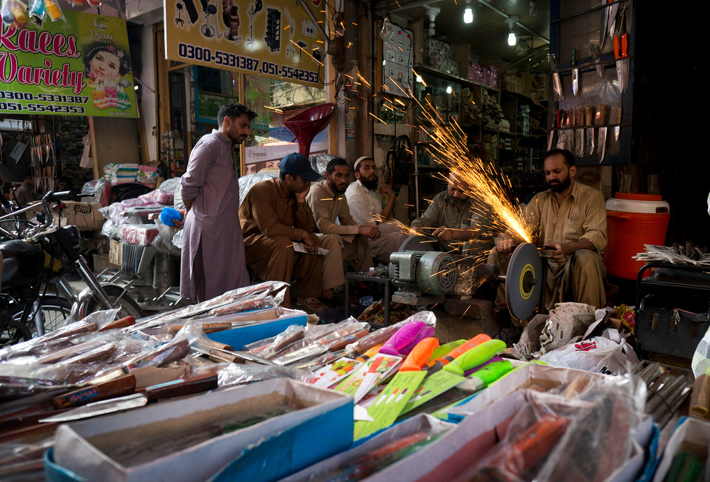 . Pakistani customers get their knives sharpened for the upcoming Muslim holiday of Eid al-Adha, in Rawalpindi, Pakistan, Monday, Sept.12, 2016. Pakistanis will celebrate the Eid al-Adha, or the Feast of the Sacrifice, on Tuesday to mark the willingness of the Prophet Ibrahim -- Abraham to Christians and Jews -- to sacrifice his son. During the holiday Muslims slaughter sheep and cattle, distribute part of the meat to the poor and eat the rest. (AP Photo/B.K. Bangash)