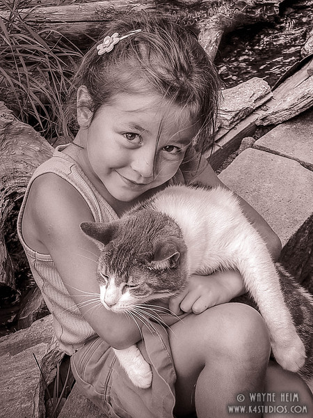 Girl and Her Kitty     Black and White Photography by Wayne Heim
