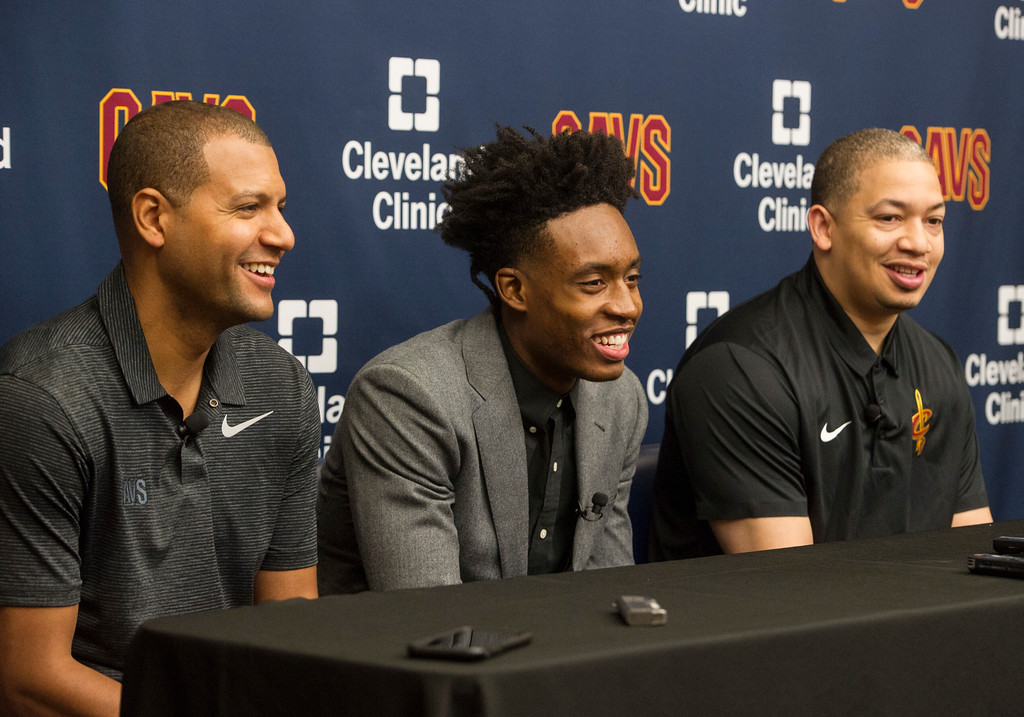 . Cleveland Cavaliers first round draft selection, Collin Sexton, center, laughs with Cavaliers general manager Koby Altman, left, and Cavaliers head coach Tyronn Lue during a news conference at the NBA basketball team\'s training facility in Independence, Ohio, Friday, June 22, 2018.  (AP Photo/Phil Long)