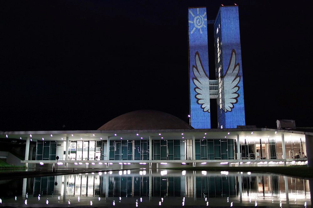 Description of . An image is projected on the towers of the National Congress during Culture Week in Brasilia November 9, 2012. Architect Oscar Niemeyer, who designed the National Congress building, remains in hospital due to worsening renal function and was transferred to the Immediate Care Unit of Hospital Samaritano in Rio de Janeiro on Friday, according to local media. REUTERS/Ueslei Marcelino