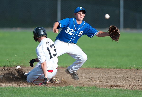 07/24/18 Wesley Bunnell | Staff Southington vs Stratford Titans in 13U Nutmeg Games baseball at Percival Field on Tuesday afternoon. Nat Cofrancesco (32) is forced to come off the base to field the throw on a stolen base by Stratford's Matt Diaz (13).