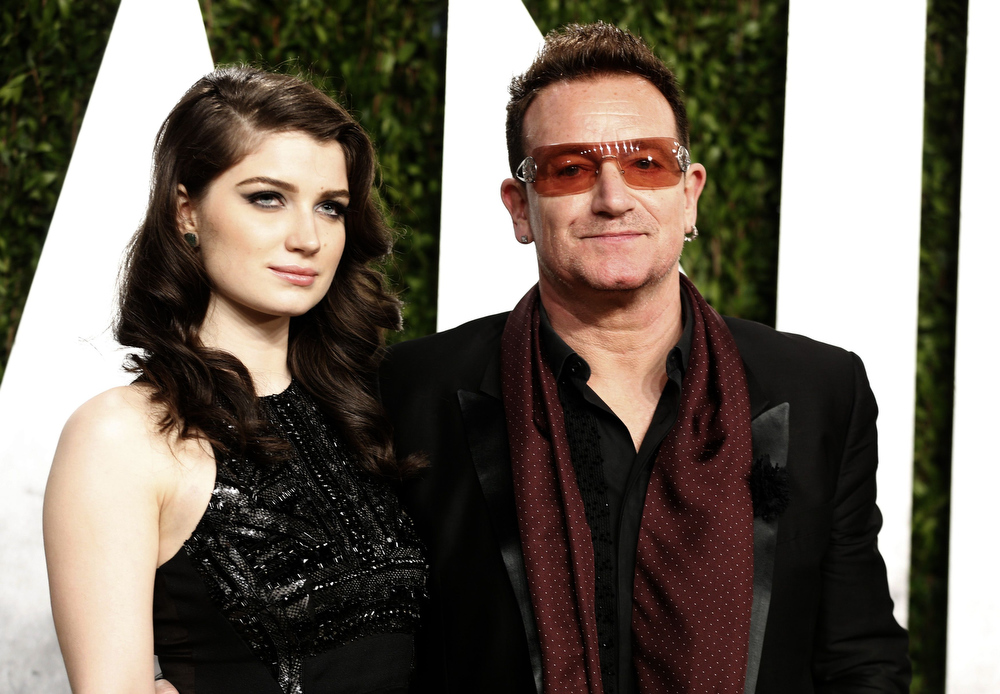 Description of . Bono (R) and his daughter Eve Hewson at the 2013 Vanity Fair Oscars Party in West Hollywood, California February 24, 2013.  REUTERS/Danny Moloshok