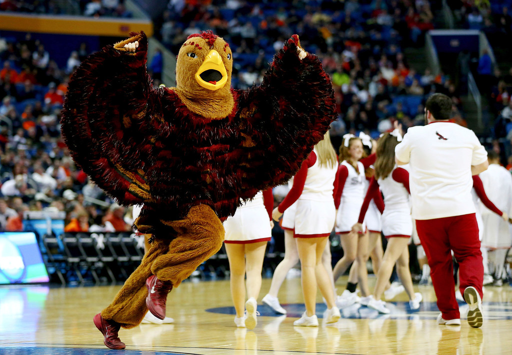 . The Saint Joseph\'s Hawks mascot perofrms during the second round of the 2014 NCAA Men\'s Basketball Tournament against the Connecticut Huskies at the First Niagara Center on March 20, 2014 in Buffalo, New York.  (Photo by Elsa/Getty Images)