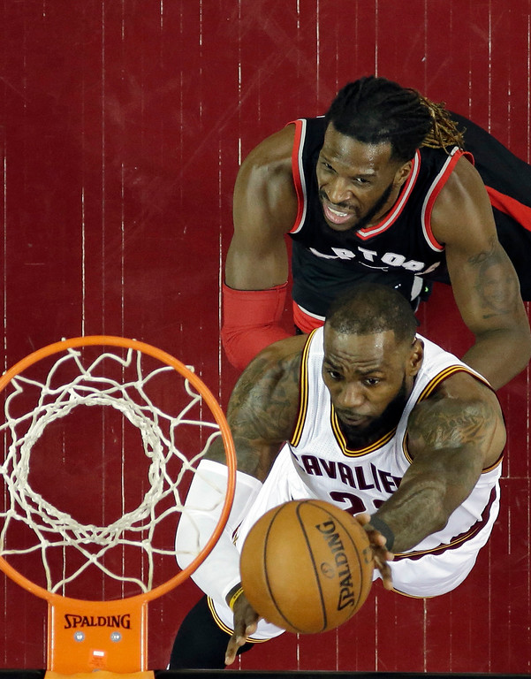 . Cleveland Cavaliers\' LeBron James drives to the basket against Toronto Raptors\' DeMarre Carroll in the first half in Game 1 of a second-round NBA basketball playoff series, Monday, May 1, 2017, in Cleveland. The Cavaliers won 116-105. (AP Photo/Tony Dejak)
