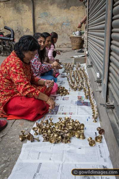 Ladies prepare candles for the temple