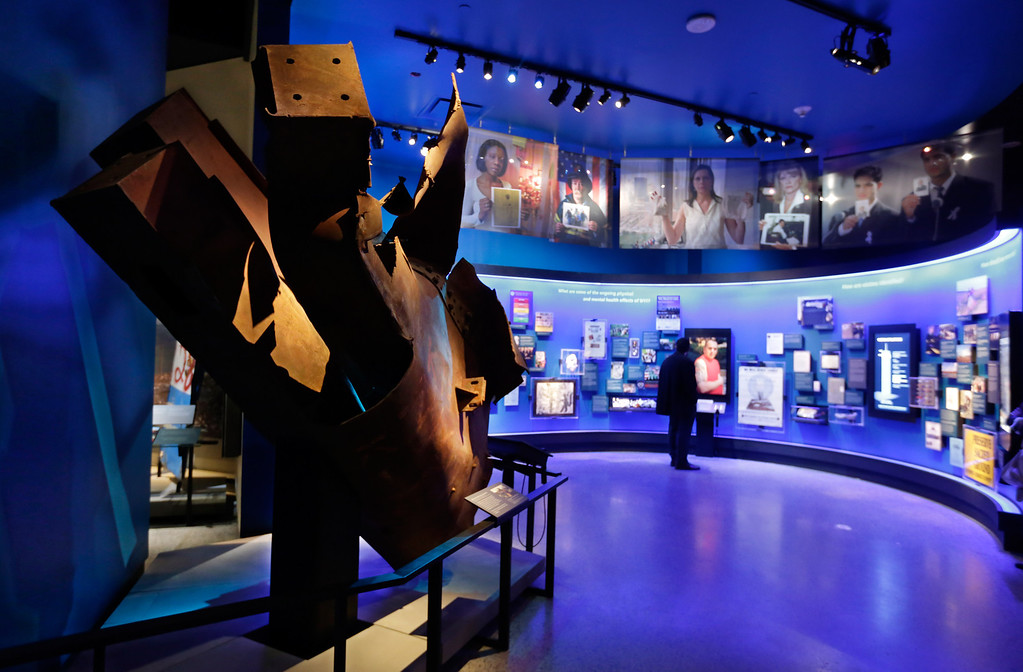 . Steel from the World Trader Center north tower floors 97 and 98, left, is displayed at the National Sept. 11 Memorial Museum, Wednesday, May 14, 2014, in New York.   (AP Photo)