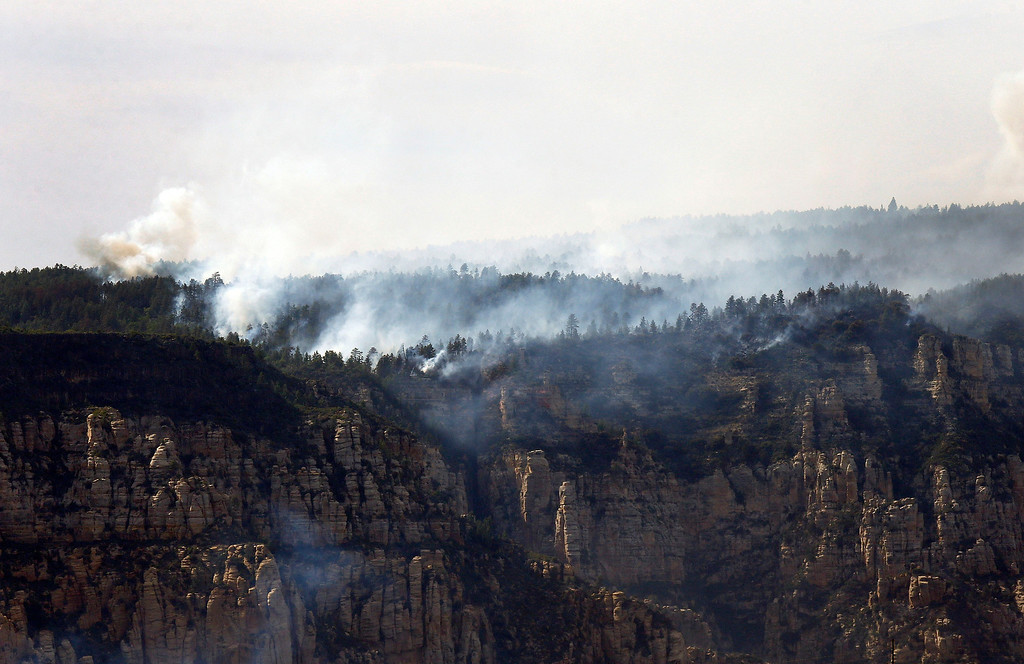 . The Slide Fire burns up Oak Creek Canyon on Thursday, May 22, 2014, in Sedona, Ariz.  The fire has burned approximately 4,800 acres. (AP Photo/Ross D. Franklin)