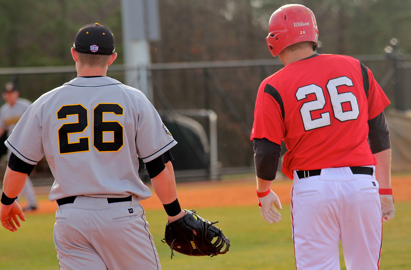 GWU Outfielder Jake Watts stands at first with opposing App. State player Trey Holmes.