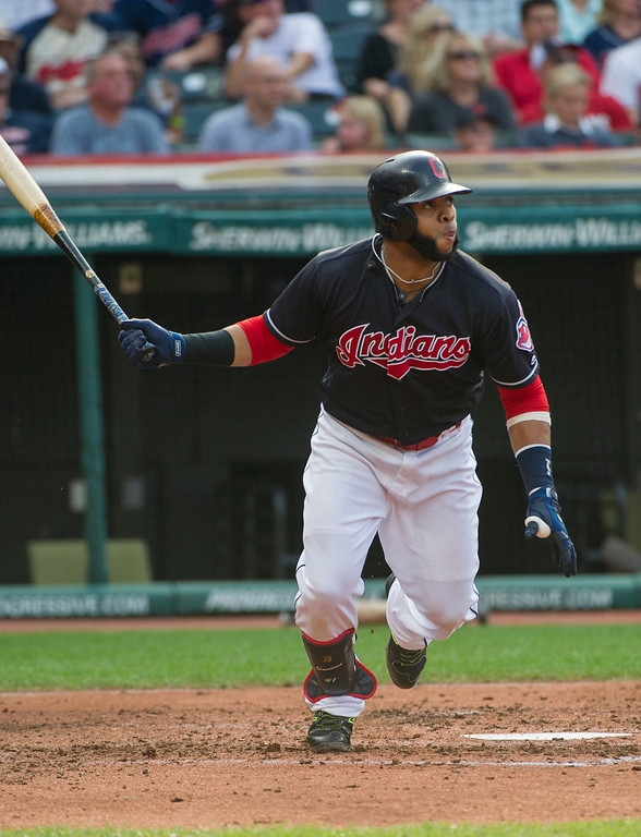 . Cleveland Indians\' Carlos Santana watches his RBI single off Kansas City Royals starting pitcher Jason Hammel during the third inning of a baseball game in Cleveland, Saturday, Sept. 16, 2017. The hit scored Francisco Lindor from second. (AP Photo/Phil Long)