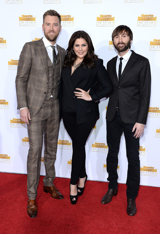 . (L-R) Charles Kelley, Hillary Scott, and Dave Haywood of Lady Antebellum attend NBC and Time Inc. celebrate the 50th anniversary of the Sports Illustrated Swimsuit Issue at Dolby Theatre on January 14, 2014 in Hollywood, California.  (Photo by Dimitrios Kambouris/Getty Images)