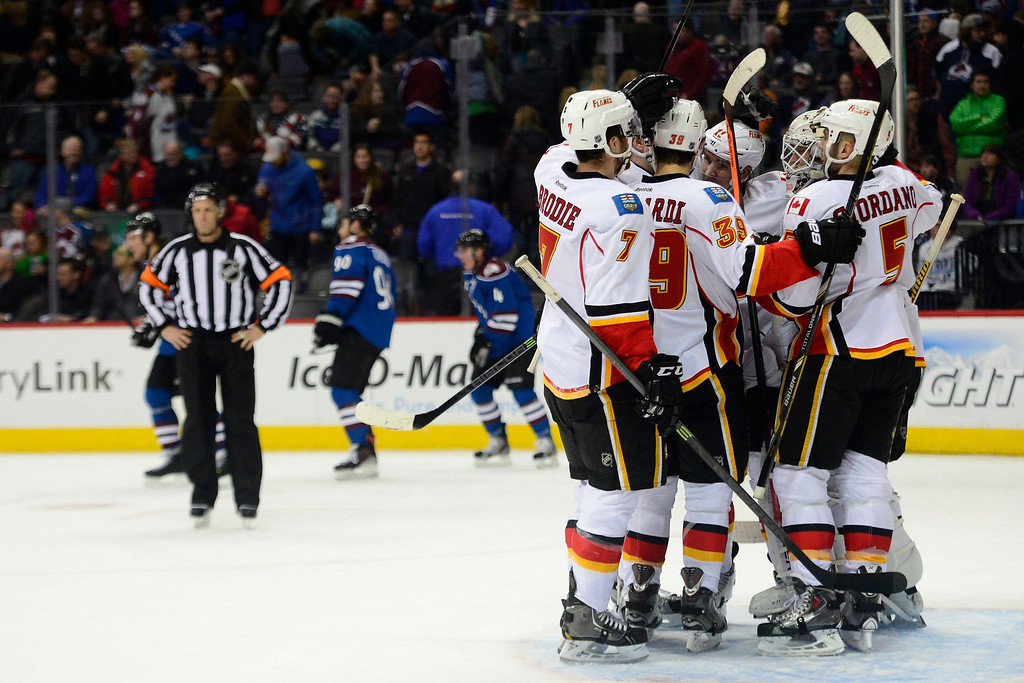 . The Calgary Flames celebrate their following their 4-3 win against the Colorado Avalanche.   (Photo by AAron Ontiveroz/The Denver Post)