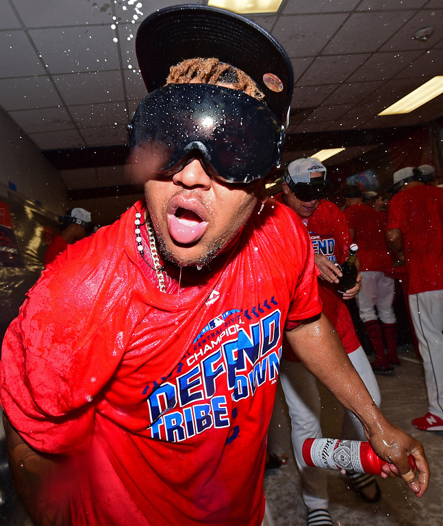 . Cleveland Indians Jose Ramirez celebrates in the clubhouse after the Indians defeated the Detroit Tigers 15-0 to clinch the American League Central Division, in a baseball game, Saturday, Sept. 15, 2018, in Cleveland. (AP Photo/David Dermer)