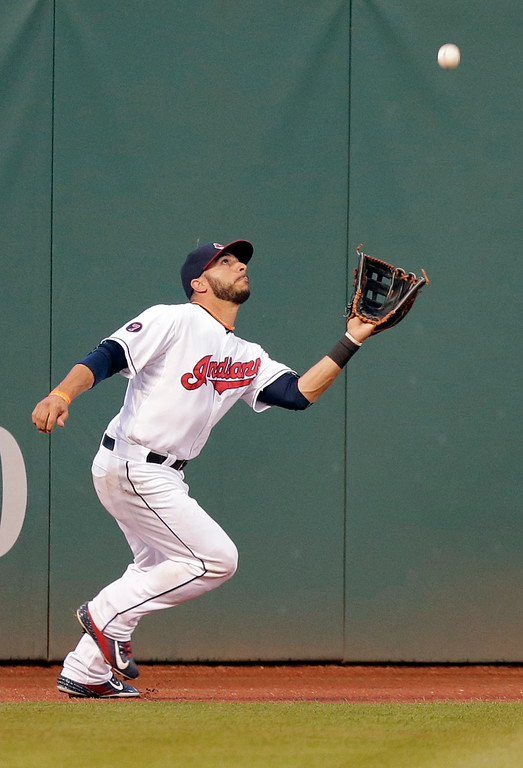 . Cleveland Indians� Mike Aviles catches a sacrifice fly hit by Detroit Tigers\' Yoenis Cespedes in the fourth inning of a baseball game, Monday, June 22, 2015, in Cleveland. Miguel Cabrera scored on the play. (AP Photo/Tony Dejak)
