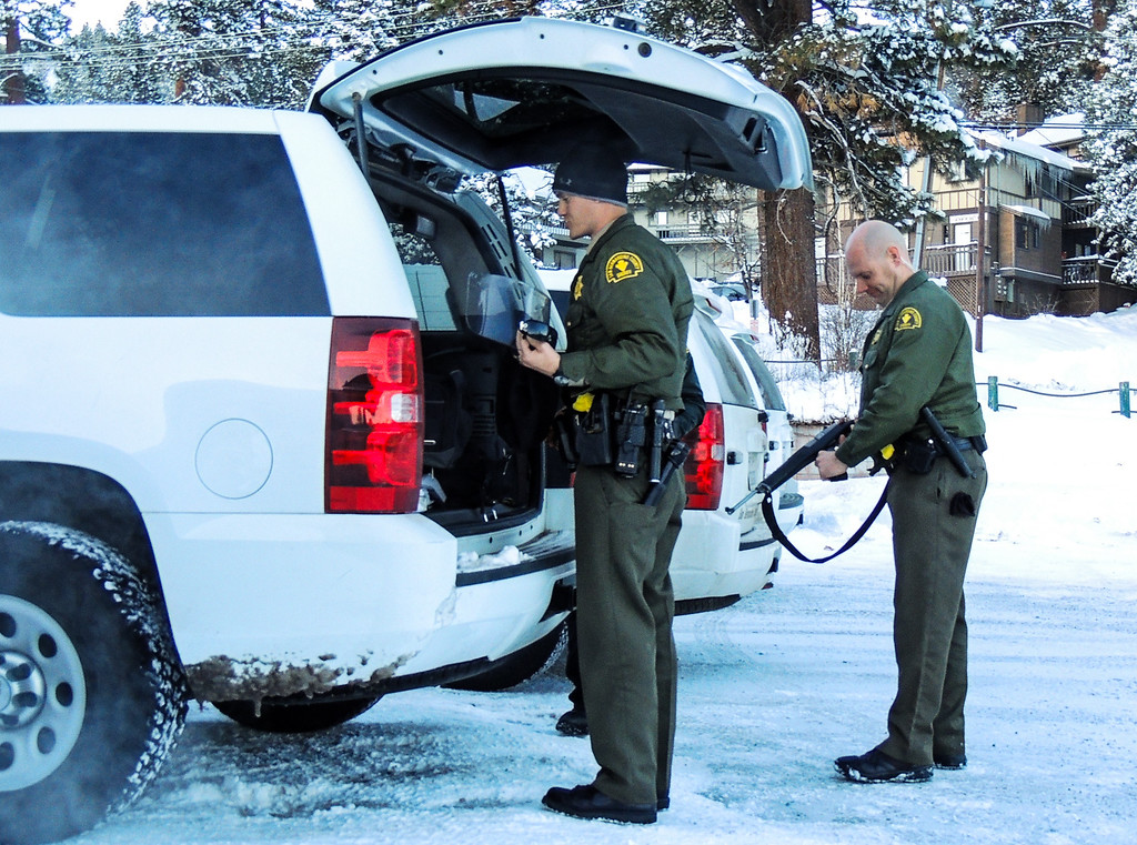 . A sheriff\'s deputies pack up and prepare to leave the command post at Bear Mountain Resort at start of day four in the search for fugitive ex-cop Christopher Dorner in Big Bear on Sunday, Feb. 10, 2013. (Rachel Luna / Staff Photographer)