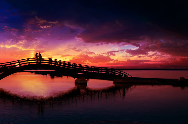 Couple enjoying the romantic sunset on the Lefkas town bridge
