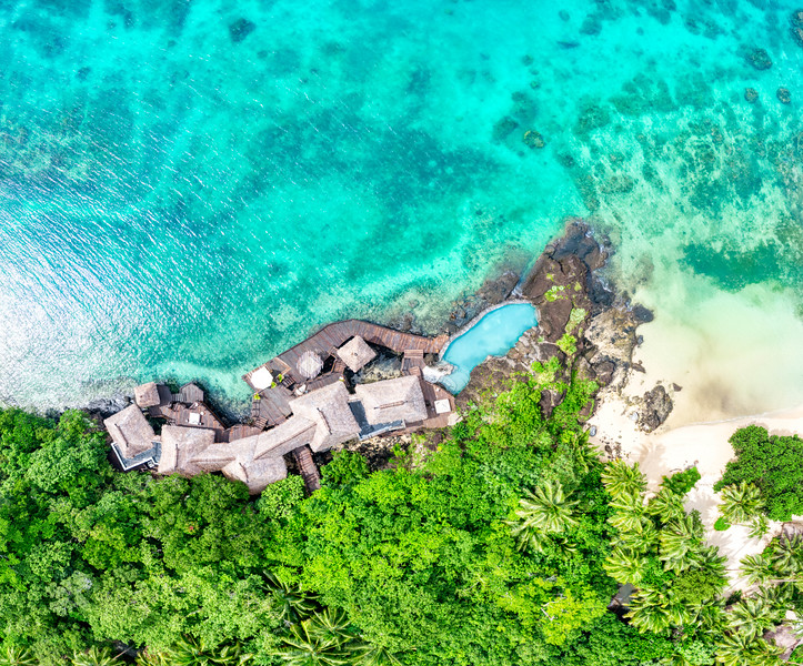 Floating over a seafront villa on Laucala Island