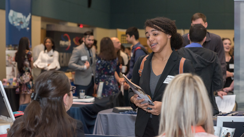 Loren Wallor talk to recruiters at the Career Fair held in the Lonestar Ballrooms on March 7th, 2018.