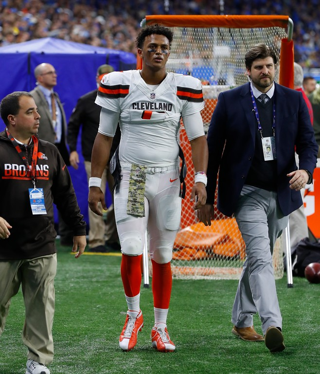 . Cleveland Browns quarterback DeShone Kizer leaves the field of play after being examined during the second half of an NFL football game against the Detroit Lions, Sunday, Nov. 12, 2017, in Detroit. (AP Photo/Paul Sancya)