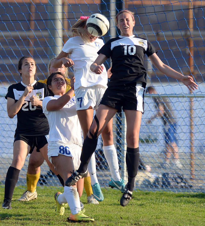 . La Habra\'s Catalina Norris (#7) heads the ball away from Sunny Hills\' Sarah Gauthier (#10) on a corner kick in their girls soccer game at La Habra High School on Thursday January 16, 2014. Sunny Hills defeated La Habra 2-0. (Staff Photo by Keith Durflinger/San Gabriel Valley Tribune)