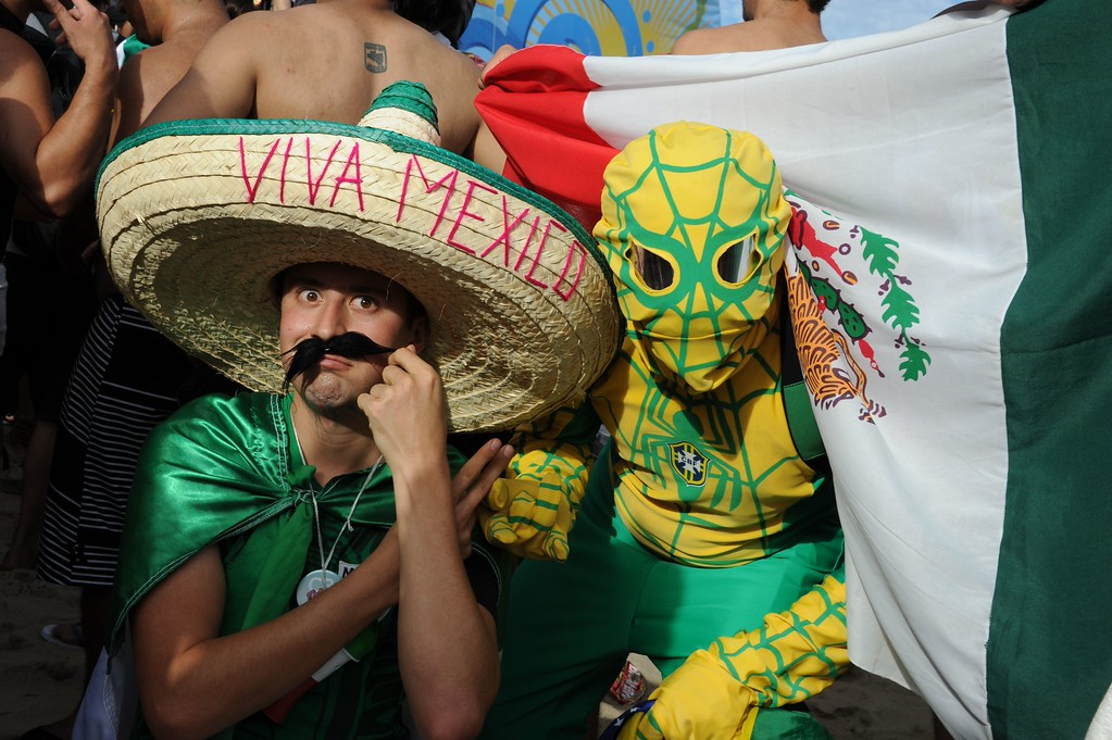 . Supporters of different countries  gather at the Fan Fest in Rio de Janeiro on June 12, 2014.   AFP PHOTO / TASSO MARCELO/AFP/Getty Images